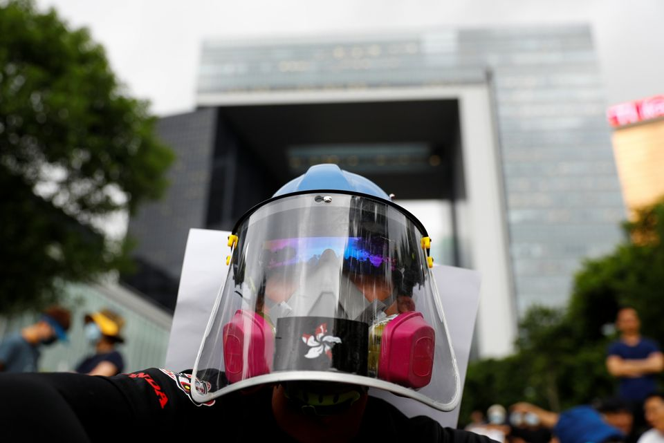 A protester takes part in a general strike at Tamar Park in front of the government buildings in Hong...