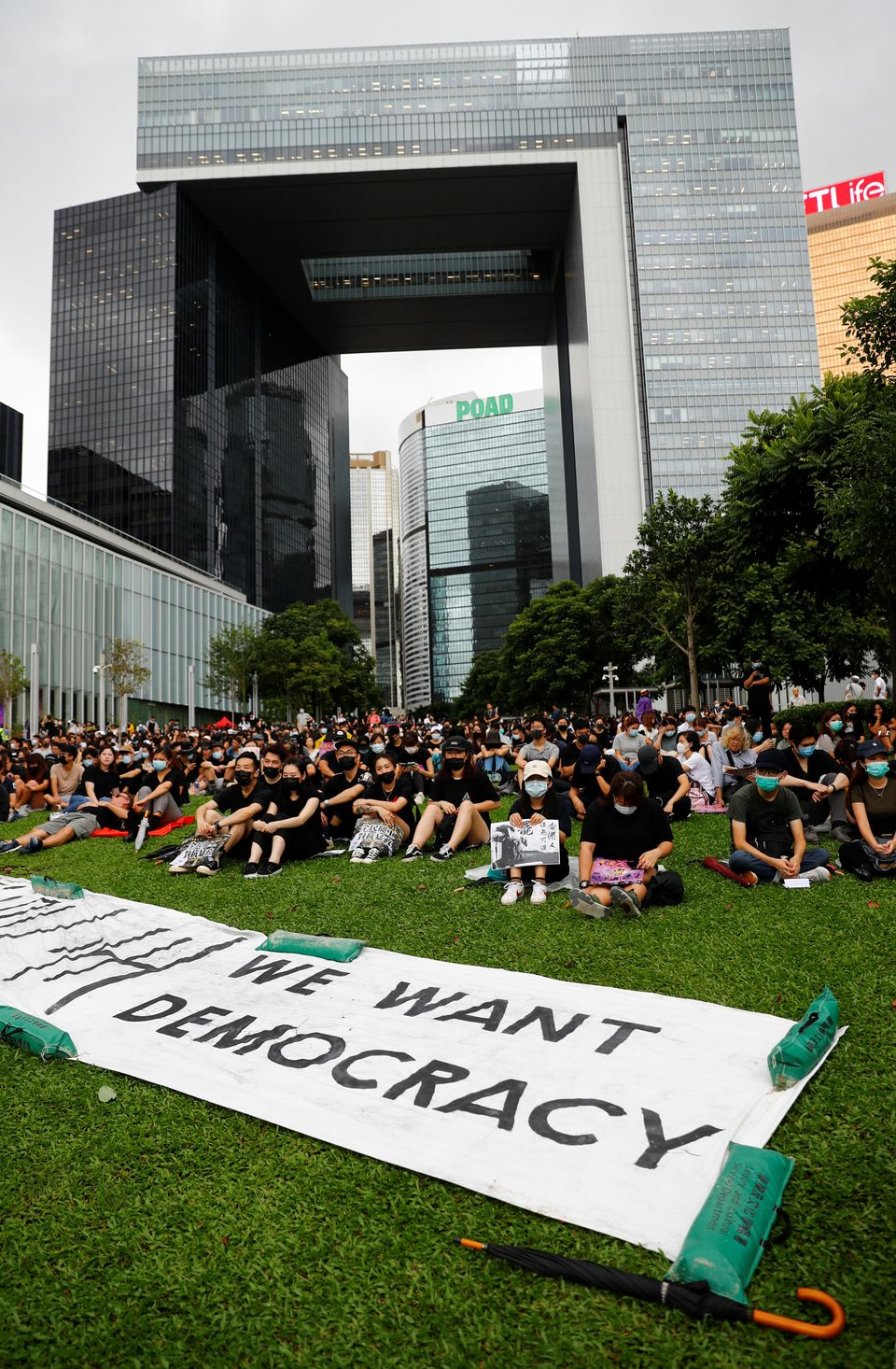 People take part in a general strike at Tamar Park in front of the government buildings in Hong Kong,...