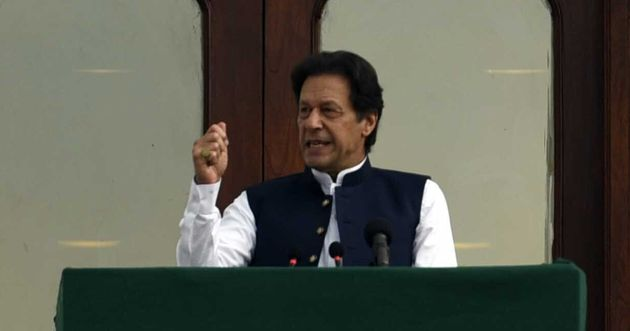 Prime Minister of Pakistan, Imran Khan addresses the crowd during a rally in front of Prime Minister...