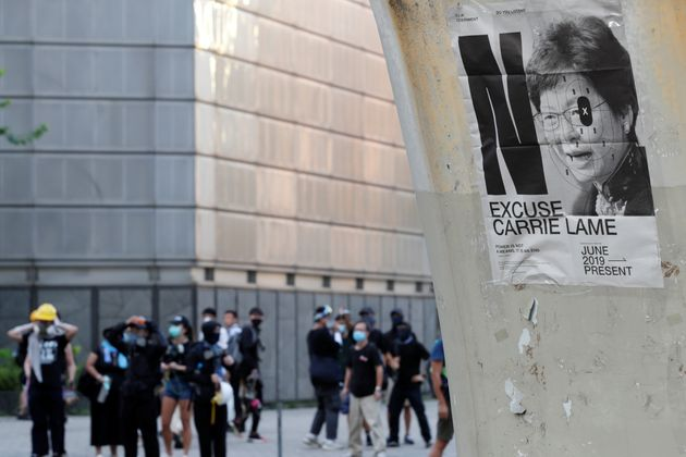 A placard depicting Hong Kong Chief Executive Carrie Lam is seen on a wall as protesters attend a demonstration...
