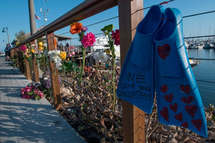 A pair of diving fins and flowers at a memorial wall near the Truth Aquatics moorings where the boat that burned and sank off the Santa Cruz islands early in the morning, was based in Santa Barbara, California on September 2, 2019.
