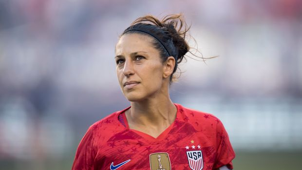 PHILADELPHIA, PA- AUGUST 29: Carli Lloyd #10 of United States of the U.S. Women's 2019 FIFA World Cup Championship team walks out with the FIFA World Cup trophy for the Victory Tour presented by Allstate match between the U.S. Women's National Team and Portugal.  The match was held at Lincoln Financial Field in Philadelphia, PA on August 29, 2019, USA. The U.S. Women's team won the match with a score of 4 to 0.  (Photo by Ira L. Black/Corbis via Getty Images)