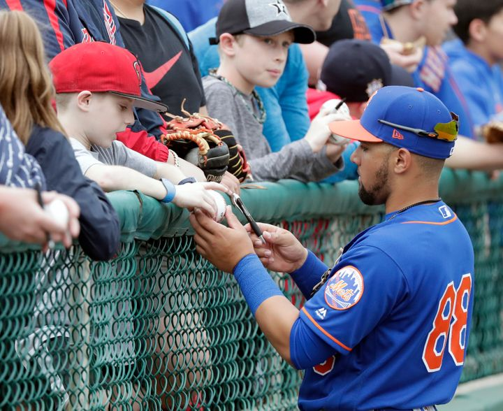 Sam Haggerty, pictured signing autographs during spring training, is a real member of the Mets following his promotion.
