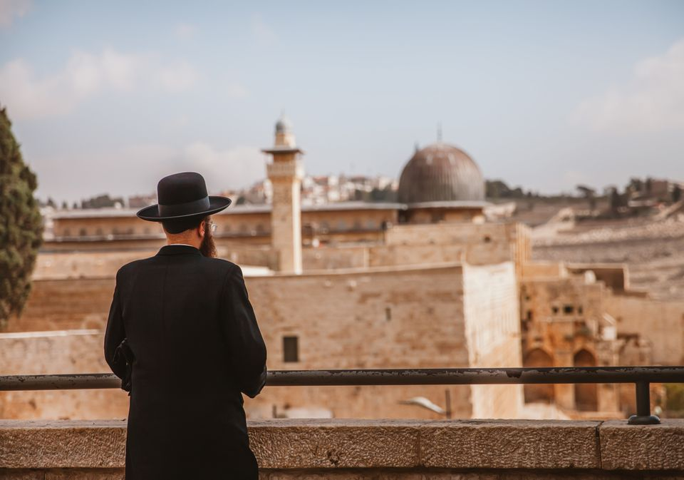 Jerusalem,Israel - November 1st,2016: A rabbi is looking at the Dome of Rock in Jerusalem.The old city...
