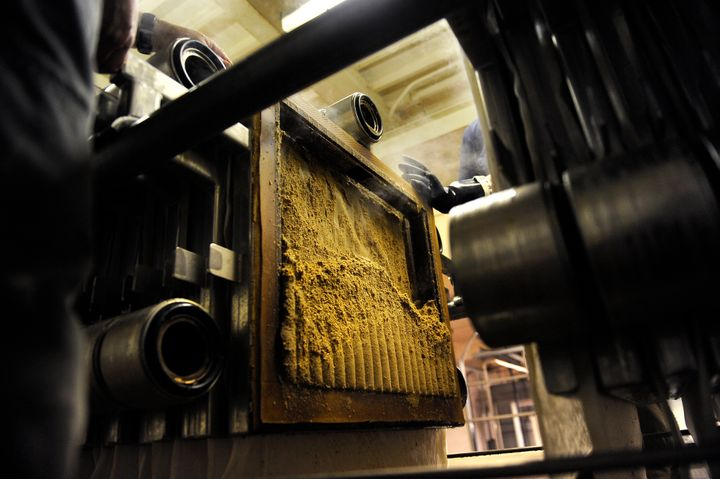 Spent grain comes out of the filter press after the wort has been sent along in the brewing process to make Colorado Native Lager in Golden, Colorado.