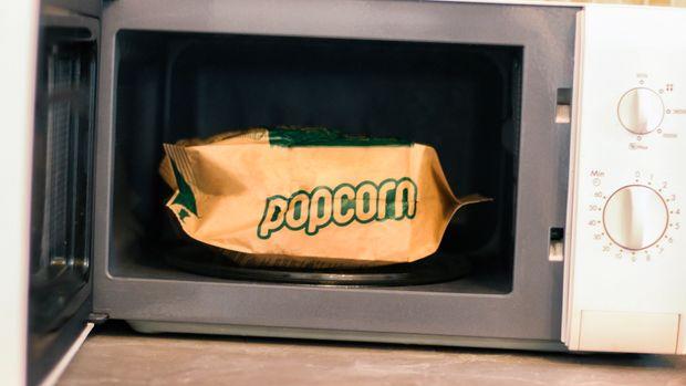 Preparing popcorn in a microwave oven.