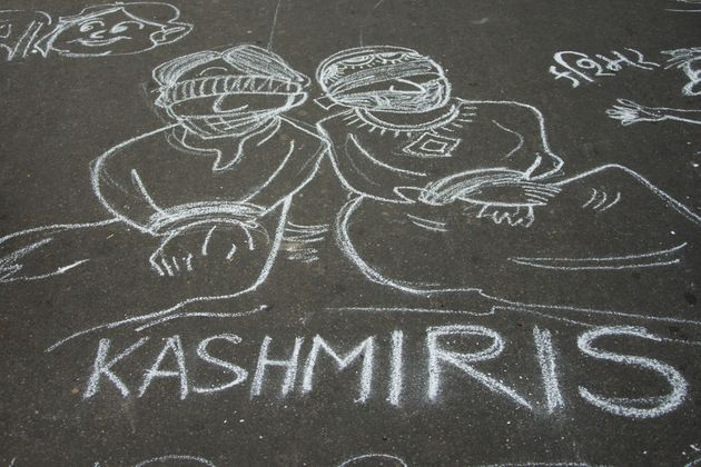 People attend a protest in solidarity with Kashmir over the removal of Article 370 and the forced shut...