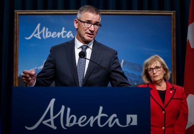 Janice MacKinnon, chair of the Blue Ribbon Panel on Alberta's Finances, looks on as Travis Toews, Minister...