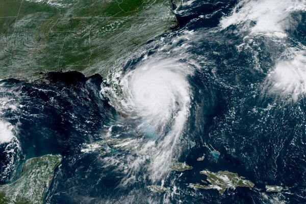 Hurricane Dorian inches northwest away from the Bahamas as a Category 2 storm in this satellite image from the National