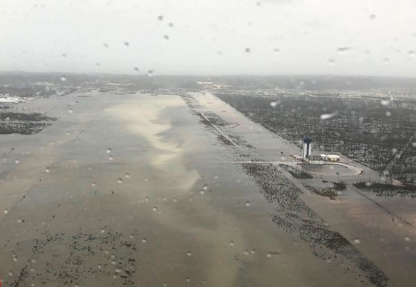 A U.S. Coast Guard photo taken Monday shows intense flooding on the runway of Marsh Harbour Airport, which serves the Ab