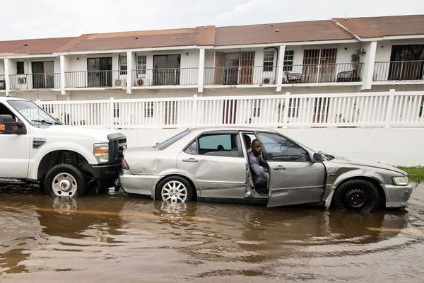 A truck pushes a stalled car through a flooded street on Monday after Hurricane Dorian ripped through Nassau, the capital of