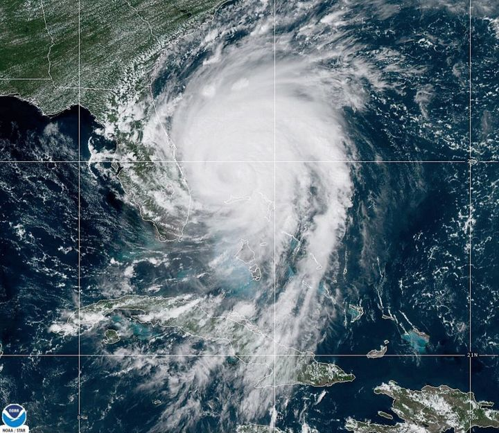 Hurricane Dorian was downgraded to a Category 2 hurricane on Tuesday after slowly crossing through the Bahamas.