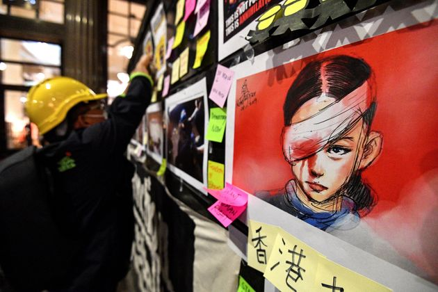 Sticky-notes carrying messages of support for Hong Kong's pro-democracy protesters and an image of a...