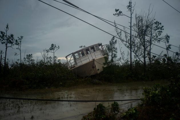 A boat thrown onshore by the Hurricane Dorian lays stranded next to a highway near Freeport, Grand Bahama,...