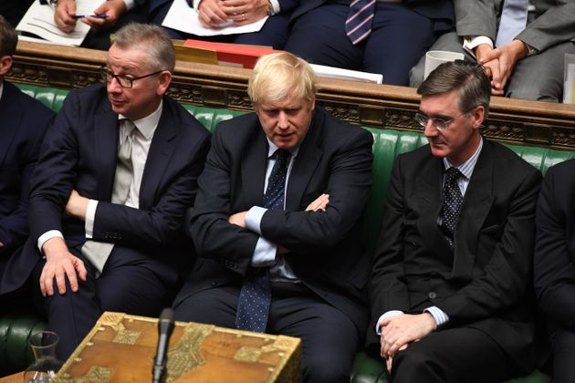 Britain's Prime Minister Boris Johnson, Chancellor of the Duchy of Lancaster Michael Gove (L), and leader...