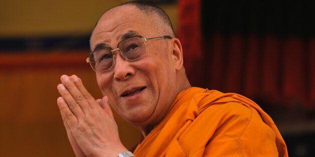 Tibetan spiritual leader the Dalai Lama greets his followers at the Buddhist cultural school in Salugara...