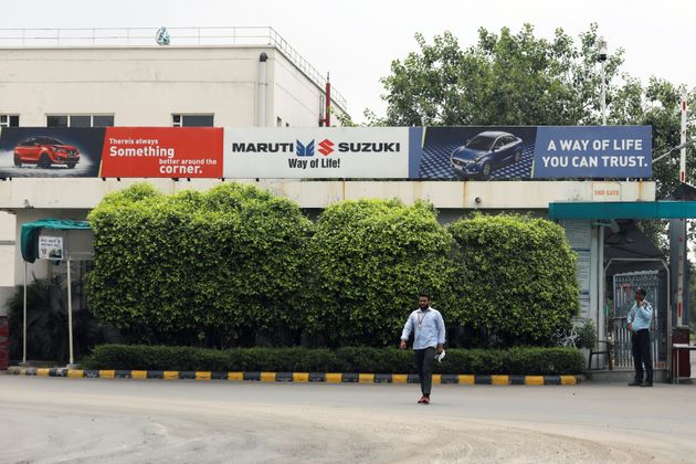 A man walks outside the Maruti Suzuki India Ltd. manufacturing plant in Manesar in the northern state...