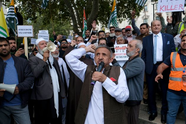 A protester speaks during the demonstration. Kashmir protesters gathered at Parliament Square to demand...