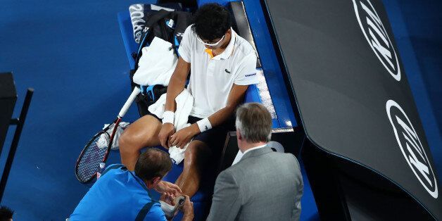 MELBOURNE, AUSTRALIA - JANUARY 26: Hyeon Chung of South Korea receives medical attention for a blistered...