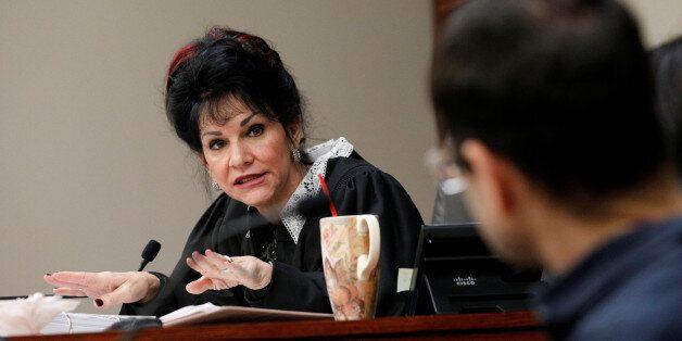 Circuit Court Judge Rosemarie Aquilina addresses Larry Nassar, (R) a former team USA Gymnastics doctor,...