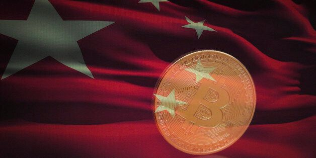 A bitcoin is seen with a Chinese flag in this photo illustration on November 4, 2017. (Photo by Jaap...