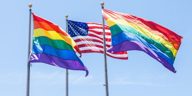 Two Rainbow Flags and a American Flag