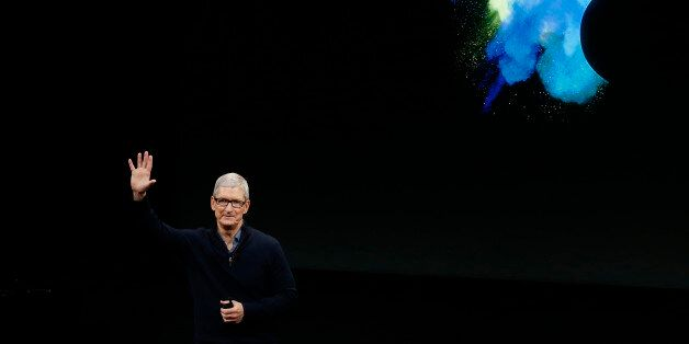 Apple CEO Tim Cook waves at the end of an Apple media event in Cupertino, California, U.S. October 27,...