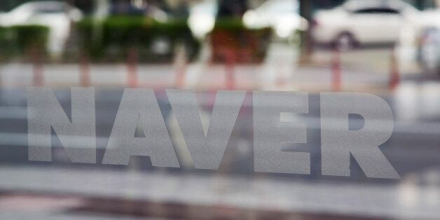 Naver Corp. signage is displayed on a glass window at the company's headquarters in Seongnam, South Korea,...