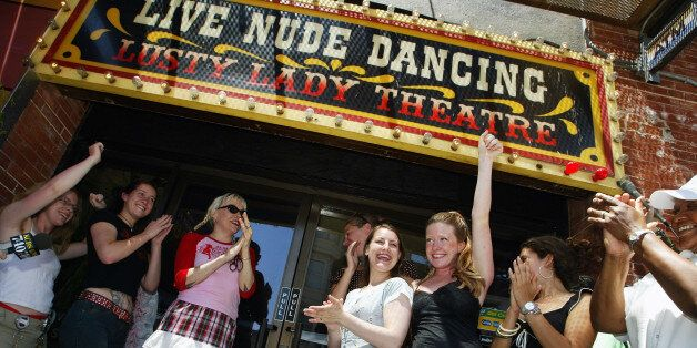 SAN FRANCISCO - JUNE 26: Exotic dancers cheer after cutting a large garter belt to officially re-opening...