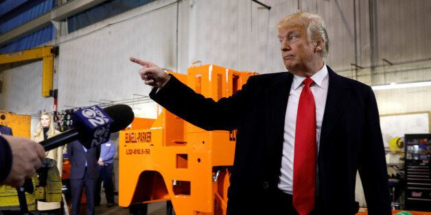 U.S. President Donald Trump gestures during a visit to H&K Equipment Company in Coraopolis, Pennsylvania,...