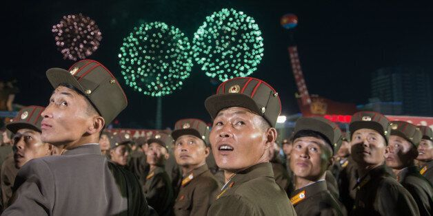 TOPSHOT - In a photo taken on September 6, 2017, Korean People's Army (KPA) soldiers cheer while watching...