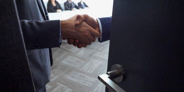 Handshake in office meeting