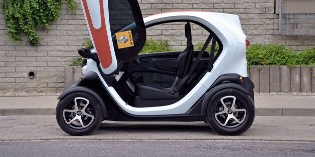 Warsaw, Poland - 6th, June, 2014: Electric micro-car Renault Twizy ZE with opening door parked on the...