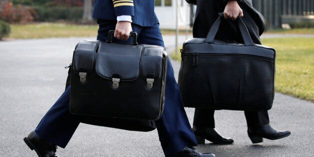 A military aide carries the