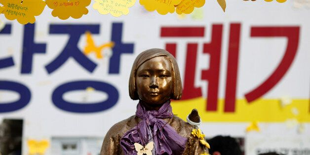 SEOUL, SOUTH KOREA - AUGUST 14: The Statue of Girl stands on the Peace Road, in front of Japanese Embassy...