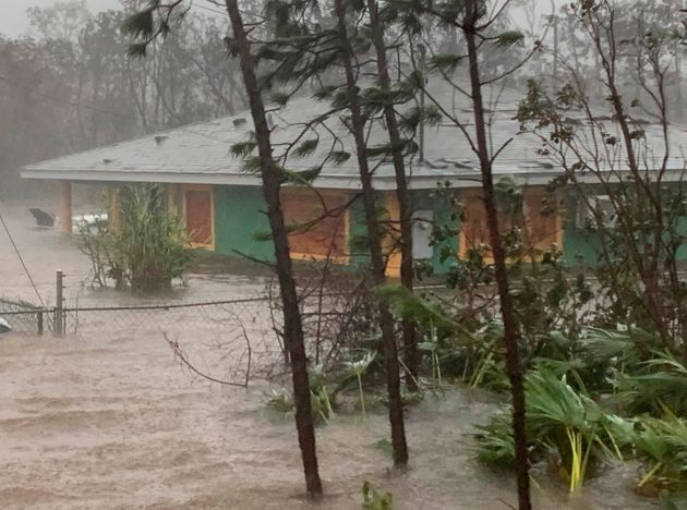 Rain from Hurricane Dorian pounds a house in Freeport on Tuesday. Nearly half of the properties on The...