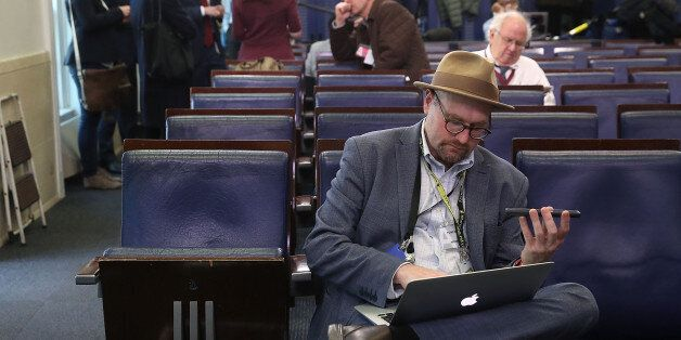 WASHINGTON, DC - FEBRUARY 24: New York Times reporter Glenn Thrush works in the Brady Briefing Room after...