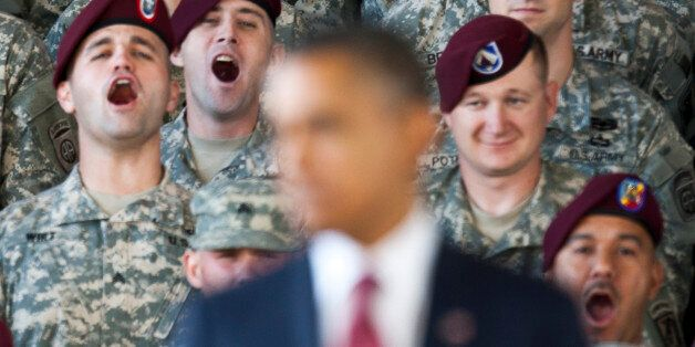 Troops yell in support at U.S. President Barack Obama as he speaks at Fort Bragg in Fayetteville, North...
