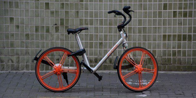 Mobike bicycles parked on a sidewalk in Jing'an district, Shanghai, a popular, new bike sharing rental...