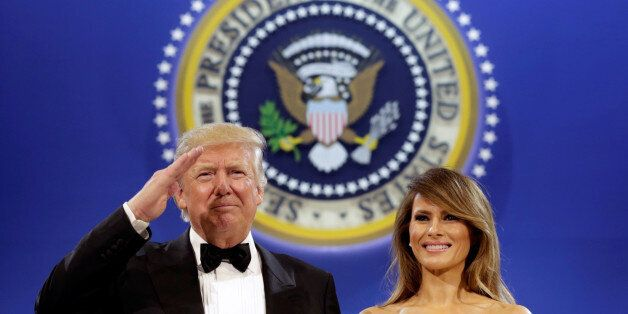 U.S. President Donald Trump salutes with his wife Melania at the Armed Services Ball in Washington, U.S.,...