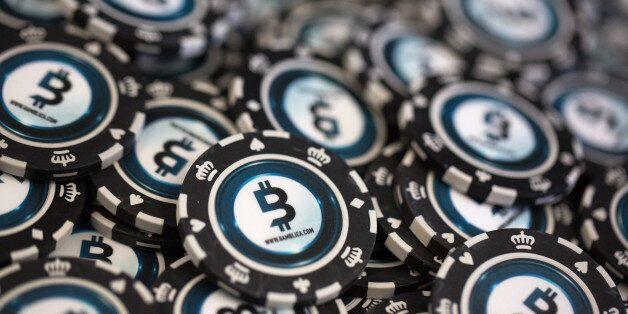Casino gambling chips decorated with bitcoin logos sit on display at the CrytoSpace conference in Moscow,...