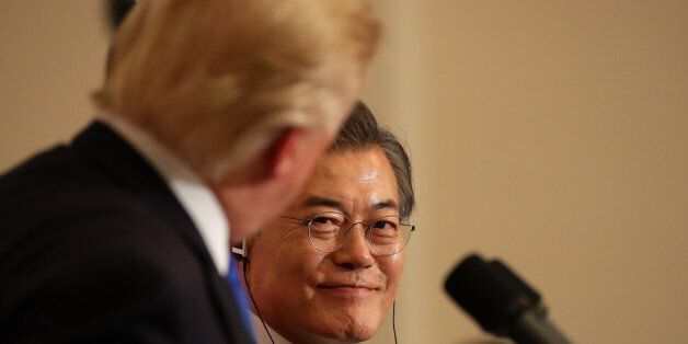 U.S. President Donald Trump, left, looks at Moon Jae-in, South Korea's president, during a news conference...