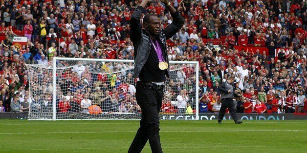 Usain Bolt on the pitch before kick-off (Photo by Dave Thompson/PA Images via Getty