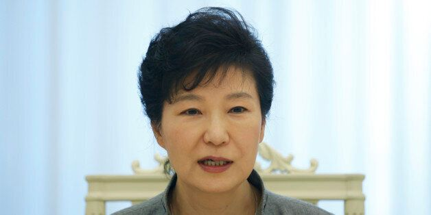 South Korean President Park Geun-hye speaks during an interview with Reuters at the Presidential Blue...