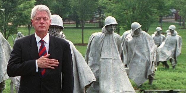 WASHINGTON, DC - JUNE 25: US President Bill Clinton (R) and South Korean ambassador to the US Hong-Koo...