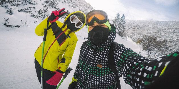 Skiers on the mountain, enjoying in skiing and making