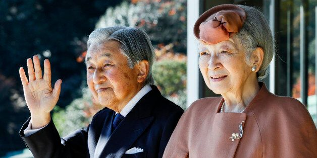 Japan's Emperor Akihito (L) and Empress Michiko wave to Luxembourg's Grand Duke Henri after their meeting...
