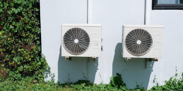 Air conditioner condenser unit at a concrete