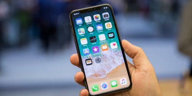 TORONTO, ON. November 3, 2017 - Creative Kelly McLaughlin shows off the iPhone X at the Apple store in...