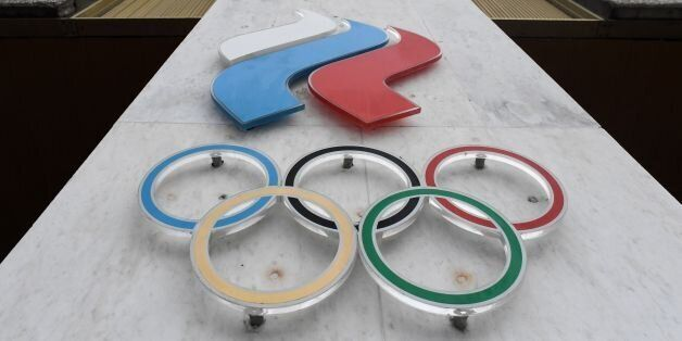 The Olympic rings are seen on the facade of the Russian Olympic Committee (ROC) building in Moscow on...